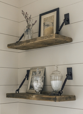 reclaimed wood handing shelves with black metal hardware and neutral decor